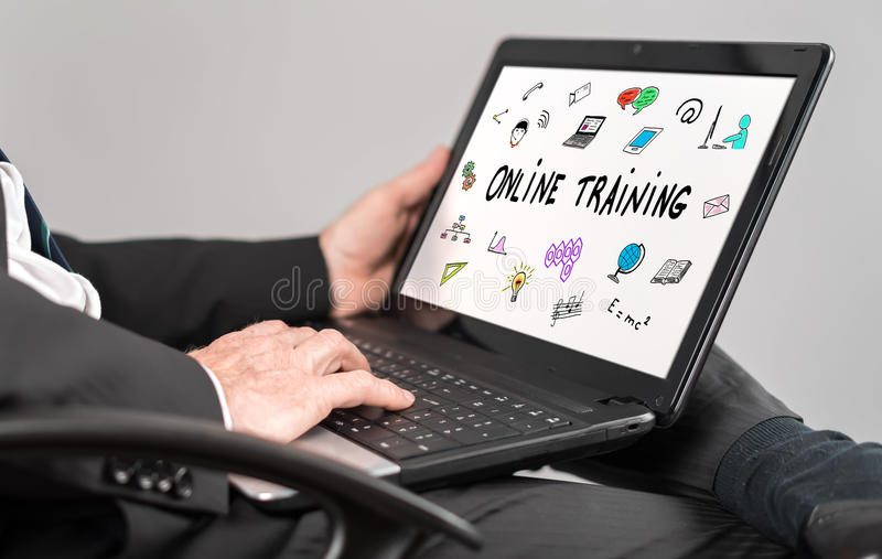 Online training concept on a laptop. Businessman watching online training concept on a laptop royalty free stock photos