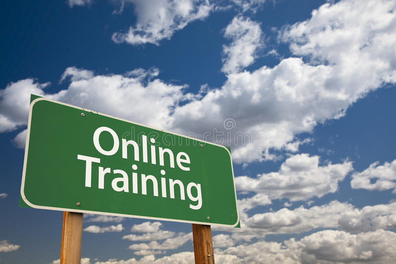 Online Training Green Road Sign Over Sky stock photo