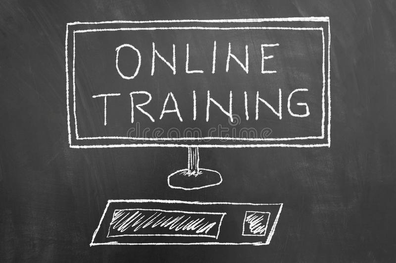Online training text and computer drawing on chalkboard stock photography