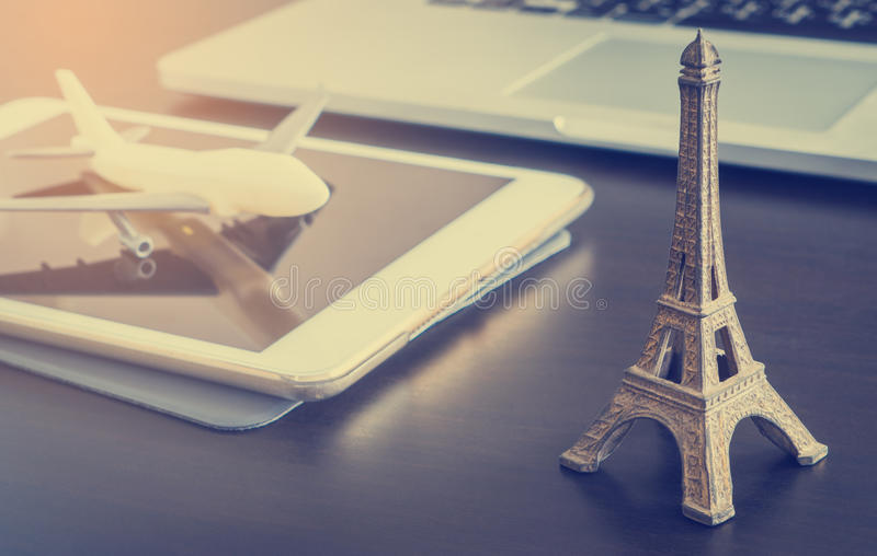 Online travel agency booking to France Paris. Online travel agency booking to France Paris vintage tone stock photos