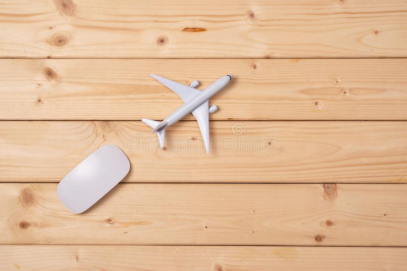Online travel booking concept. Airplane model and computer mouse royalty free stock photos
