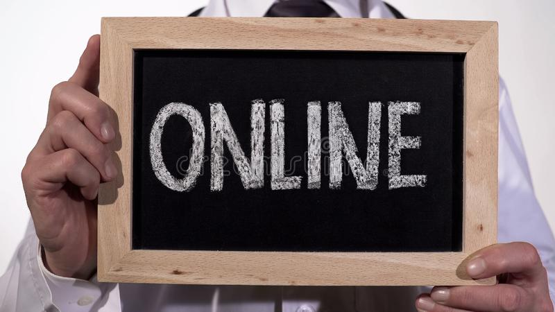 Online written on blackboard in therapist hands, medical consultation, internet. Stock footage royalty free stock photos