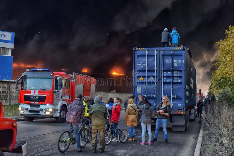 Onlookers gathered to watch a huge fire stock images