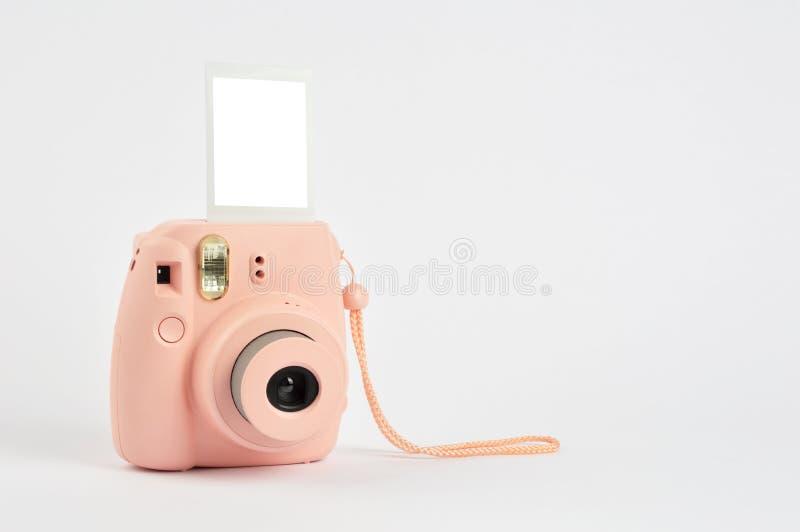 Onmiddellijke camera op witte achtergrond royalty-vrije stock afbeeldingen