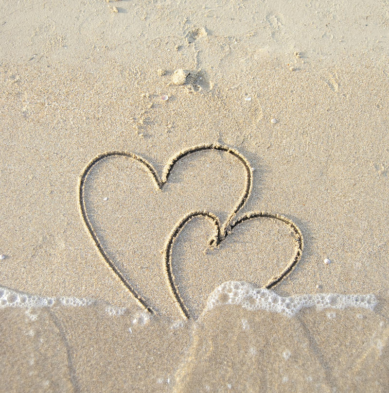 Free Сonnected Hearts Drawn On Wet Sand Stock Photo - 11626790