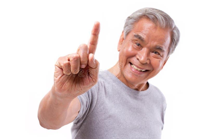 Ono uśmiecha się, szczęśliwy starszy mężczyzna wskazuje w górę 1 palca, liczy 1 rękę si zdjęcia stock