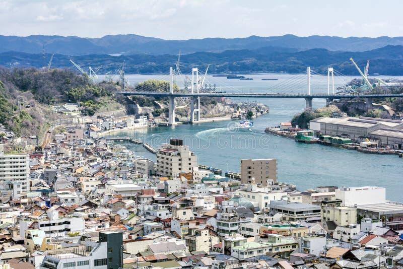 Onomichi city urban area. And bridge across the strait stock image