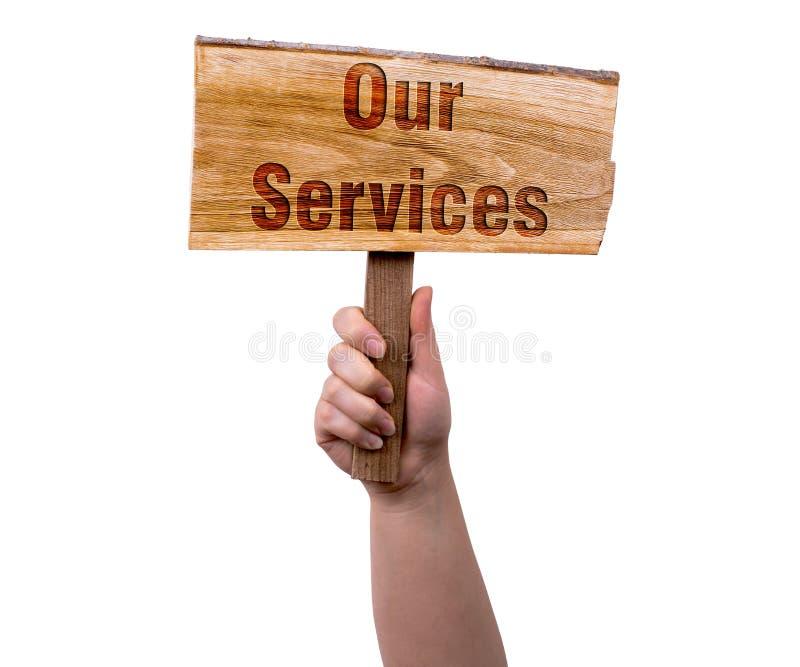 Ons de diensten houten teken stock afbeeldingen