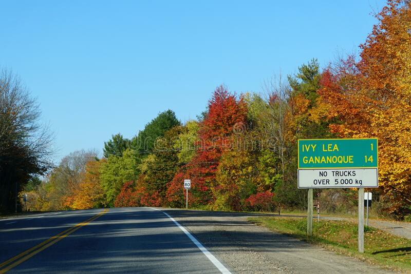 Ontario, Canada - October 28, 2019 - The view of the road towards Ivy Lea and Gananoque with striking fall foliage royalty free stock photography