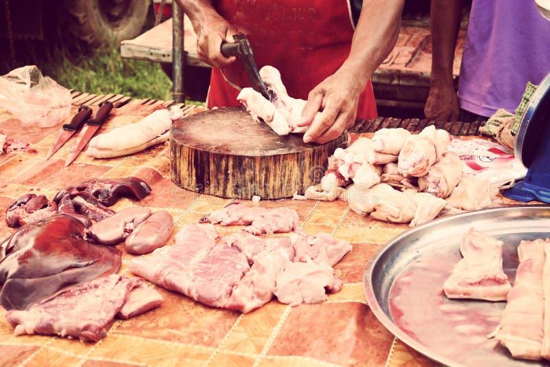 Ontleed varken naast zijgangmarkt stock fotografie
