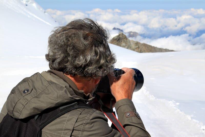Ontspruitende ijs, sneeuw en wolken van Jungfraujoch stock fotografie