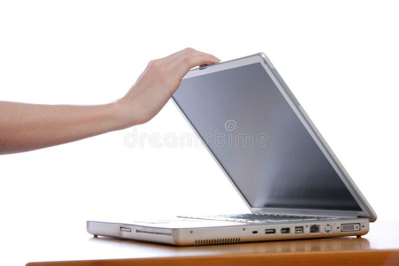 Ontspruitende laptop stock afbeeldingen