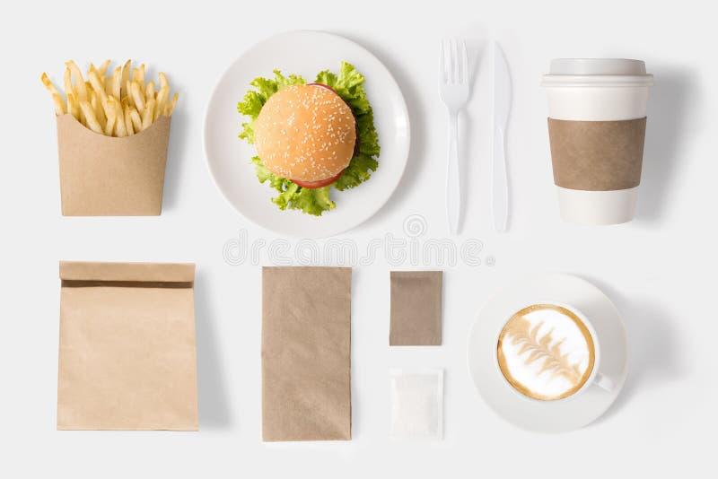 Ontwerpconcept spot op hamburger en koffie op witte backgro wordt geplaatst die royalty-vrije stock afbeelding