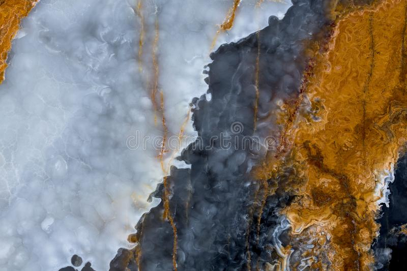 Onyx background with three colour line close up. stock image