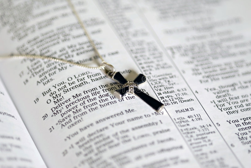 Onyx Cross on Bible Text stock image