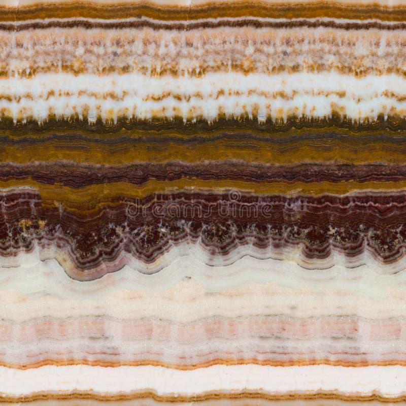 Onyx verschillende tonen van geel-bruine kleur De naadloze vierkante achtergrond, betegelt klaar royalty-vrije stock foto's
