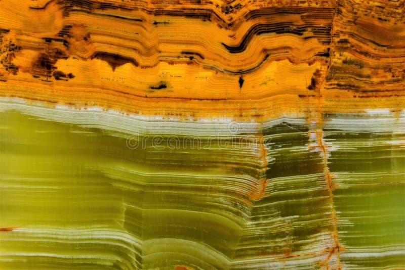 Onyxstein, Marmorschmutzhintergrund Eine Besonderheit der Beschaffenheit von Onyx – seine gestreifte Farbe, verwendet im Schmuc lizenzfreies stockfoto