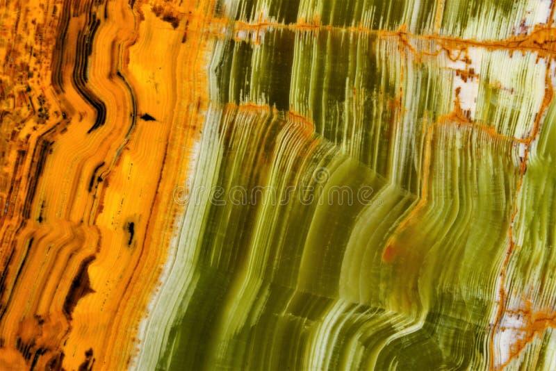 Onyxstein, Marmorschmutzhintergrund Eine Besonderheit der Beschaffenheit von Onyx – seine gestreifte Farbe, verwendet im Schmuc stockfotos