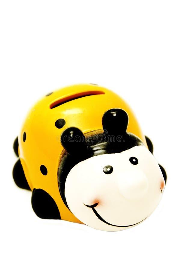 Onzelieveheersbeestje -onzelieveheersbeestje-moneybox royalty-vrije stock afbeelding
