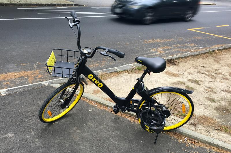 OnzO bike. AUCKLAND - NOV 10 2017:A lone OnzO on the side of the road. Onzo is a new bike-share scheme in Aucland, New Zealand royalty free stock photos