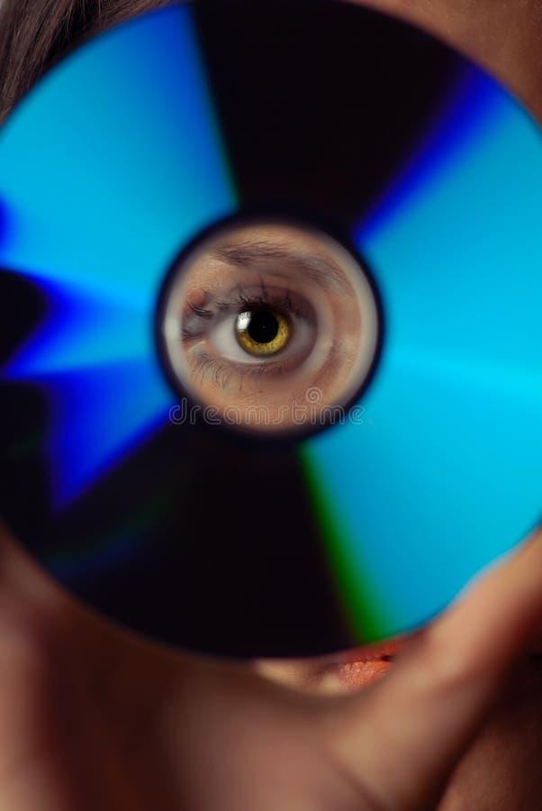 Oog en compact-disc stock afbeelding