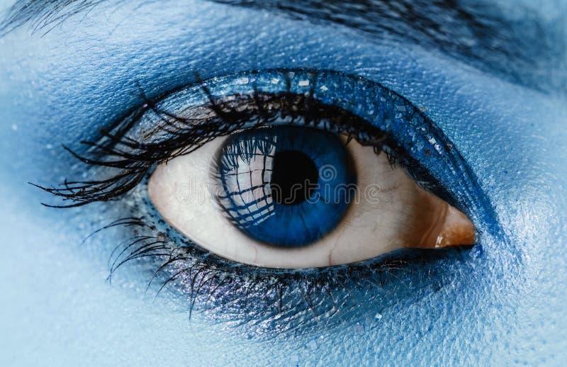 Oog met blauwe samenstelling royalty-vrije stock afbeelding