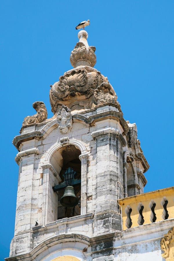 ooievaar op toren van Church Igreja do Carmo in Faro royalty-vrije stock foto