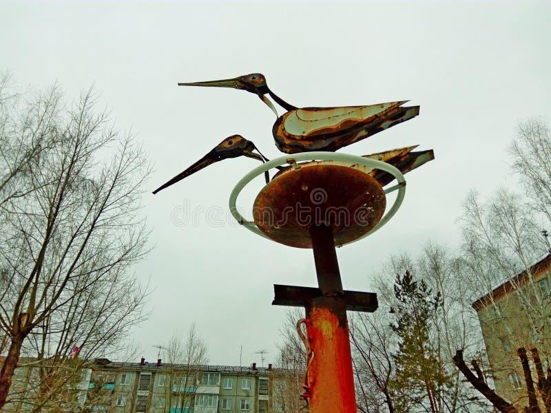 Ooievaars in het nest royalty-vrije stock afbeeldingen