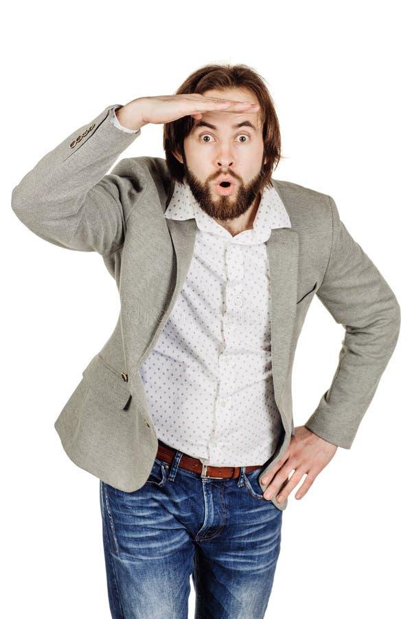 Ooking бизнесмена отсутствующий пока держащ его руку над его наблюдает к стоковое фото