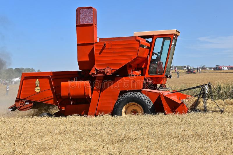 Oold Case self propelled combine. ROLLAG, MINNESOTA, September 1, 2018: An old Case self propelled combine participates in a field demonstration at the annual stock images
