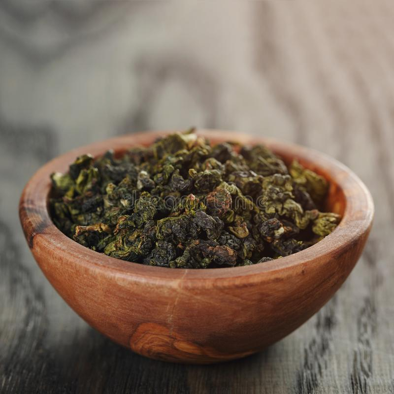 Oolong green tea in olive bowl stock photo