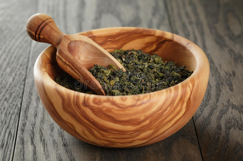 Oolong green tea in wood bowl royalty free stock image
