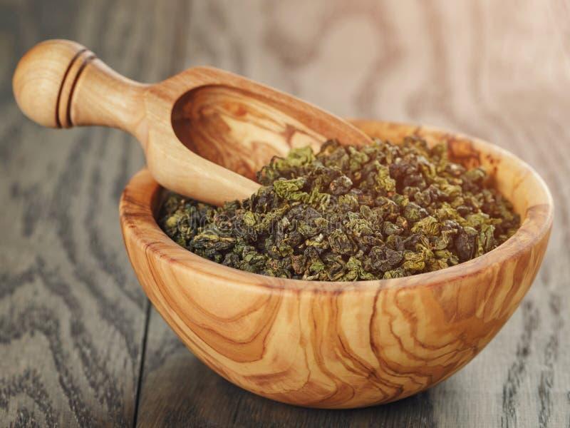 Oolong green tea in wood bowl stock photo