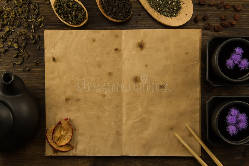 Oolong tea in wooden spoon on a background of old vintage books. royalty free stock photography