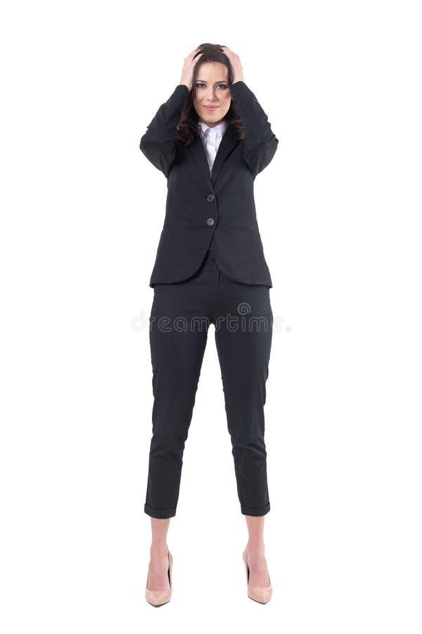 oops Concetto di rammarico Il giovane datore di lavoro affascinante della donna di affari ha fatto l'errore con la testa in mani fotografie stock