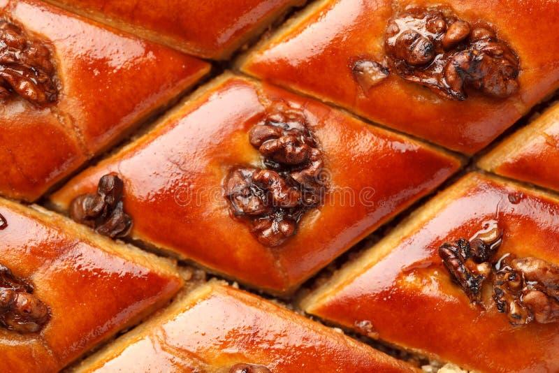 Oosterse snoepjes met okkernoot abstracte textuur, hoogste mening stock afbeeldingen