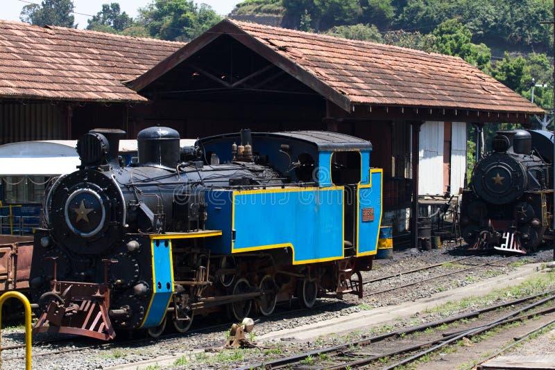 OOTY, TAMIL NADU, INDIA, 22 March 2015 : Nilgiri mountain railway. Blue train. Unesco heritage. Narrow-gauge. Steam. OOTY, TAMIL NADU, INDIA, 22 March 2015 royalty free stock image
