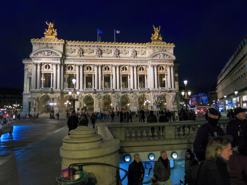 Opéra, building and metro entrance. The famous `Opéra` in Paris, France. at night, with metro entrance in the foreground stock photos
