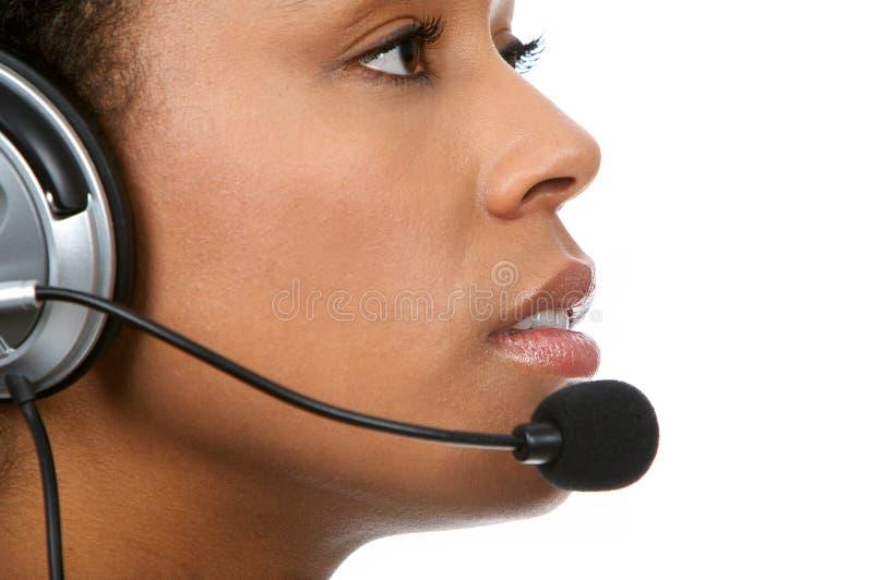 Opérateur de centre d'attention téléphonique photographie stock
