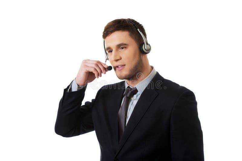 Opérateur de sourire heureux de téléphone de support à la clientèle image stock