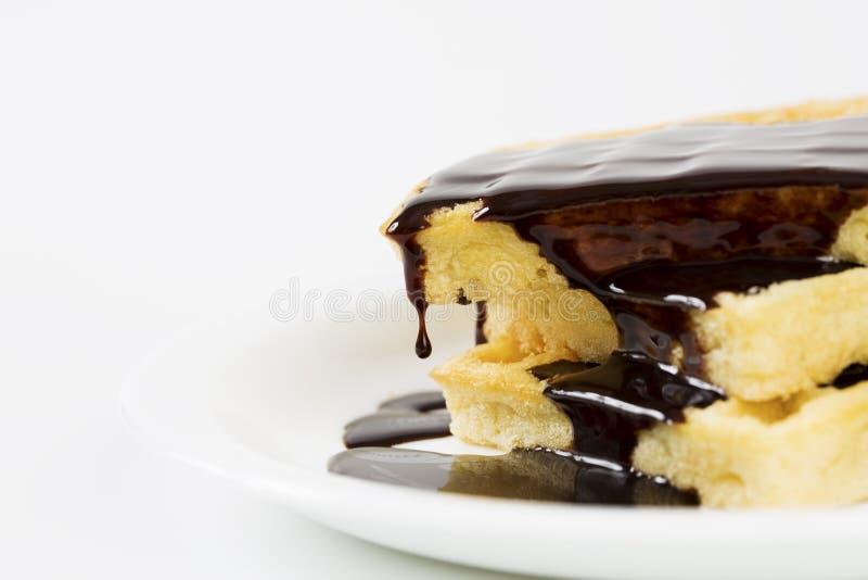 Opłatki nalewający czekoladą obraz stock