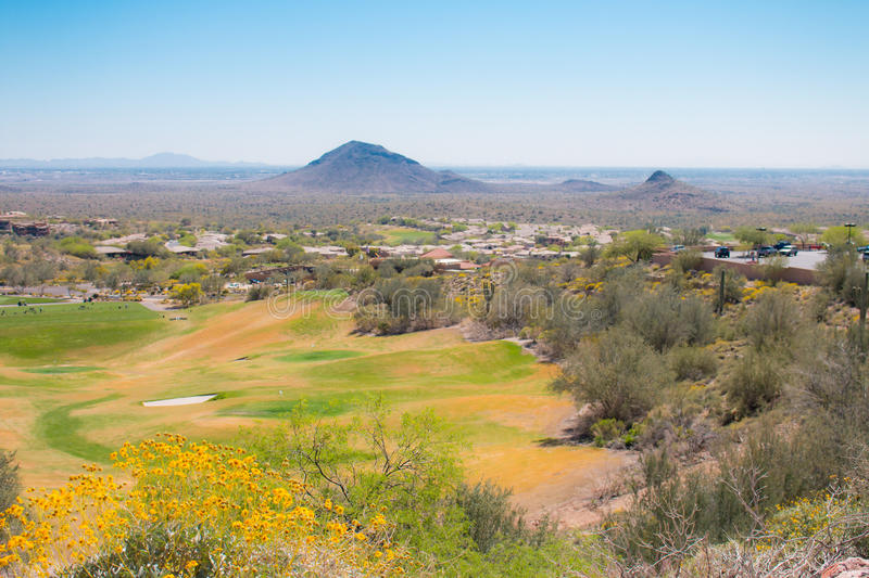 Op view of golf course in desert landscape. stock photos