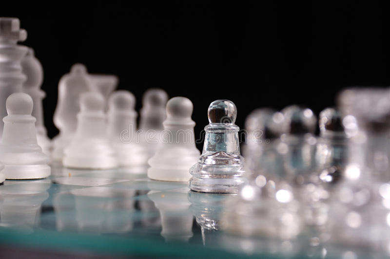 Opaque and clear chess set. royalty free stock photos