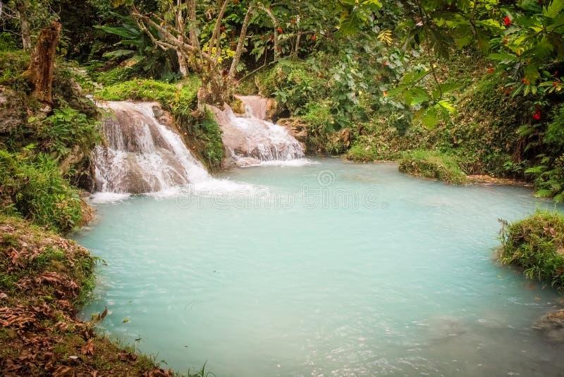 Mele Cascades Waterfall Port Vila Vanuatu. Opaque Turquoise waters of Mele Cascades Waterfall Port Vila with Tropical jungle Vanuatu royalty free stock photography