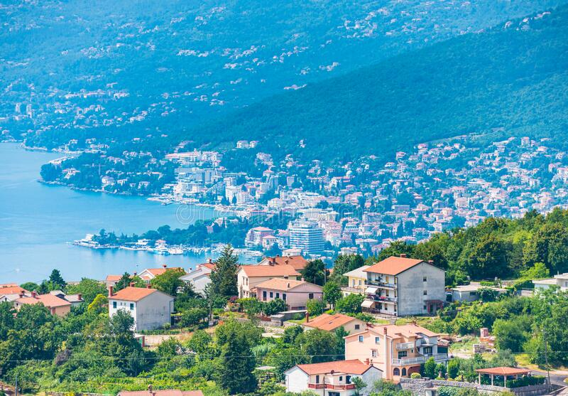 Opatija city in Croatia view from above with blue water of Kvarner bay on a sunny day stock photos