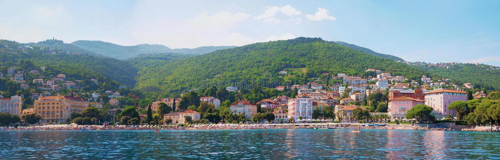 OPATIJA, CROATIA, August 9th, 2019 - popular coastal resort Kvarner Bucht, Opatija Riviera. View from the boat trip to the beach and hills ucka stock photography