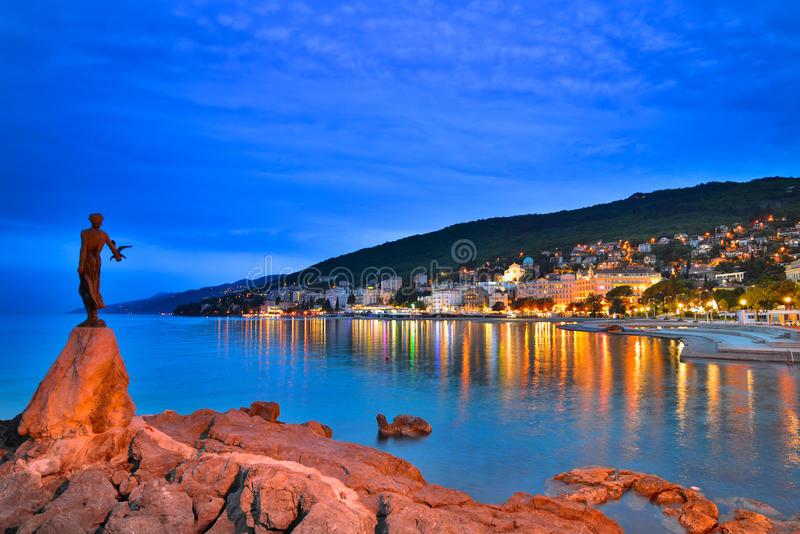 Opatija by night with girl with Seagull stock photos