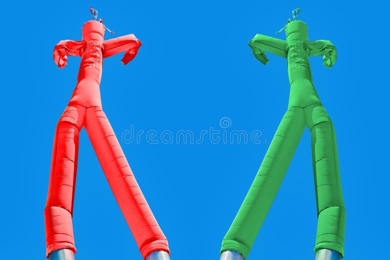 Opblaasbare mens twee Groen en rood Keuzenconcept stock afbeeldingen