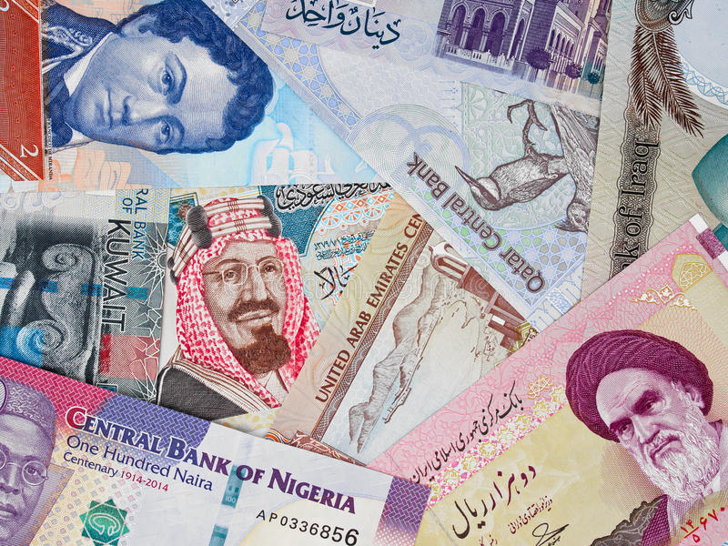 OPEC countries money, heap of various international banknotes, c stock image