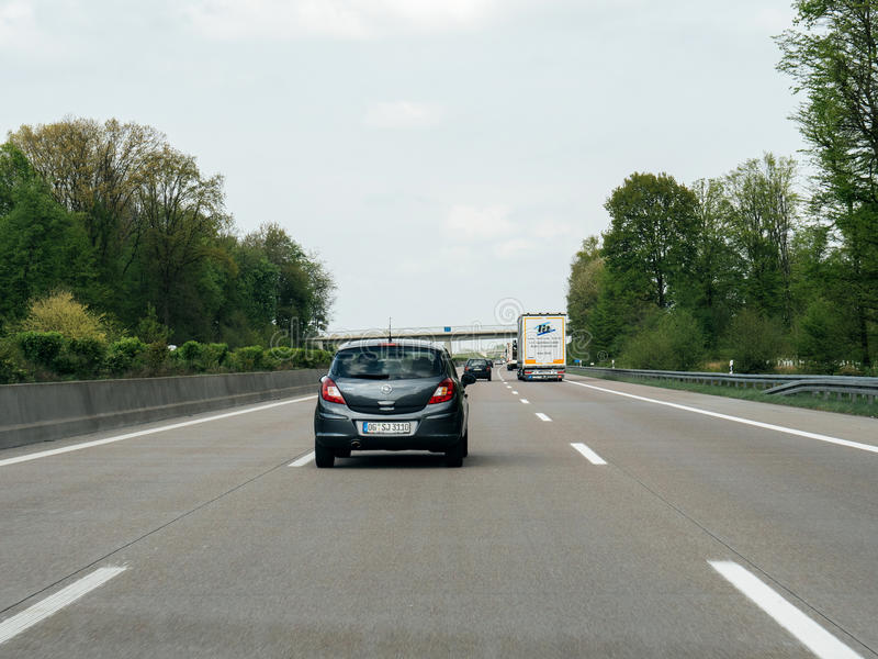 Opel Corsa car rear view on autobahn. FRANKFURT, GERMANY - APR 13, 2017: Driver point of view pov of black Opel Corsa driving on German Autobahn Bundesautobahn royalty free stock images